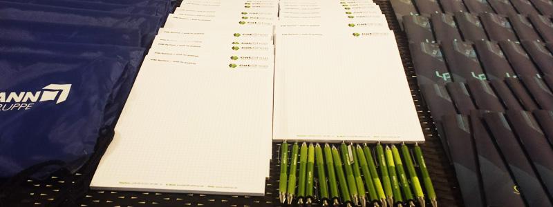 ABAKUS auf der Up-Date Konferenz 2016 - Notizblöche und Stifte für die Teilnehmer
